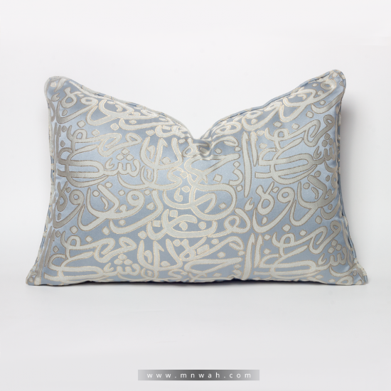 A cushion decorated with Arabic letters